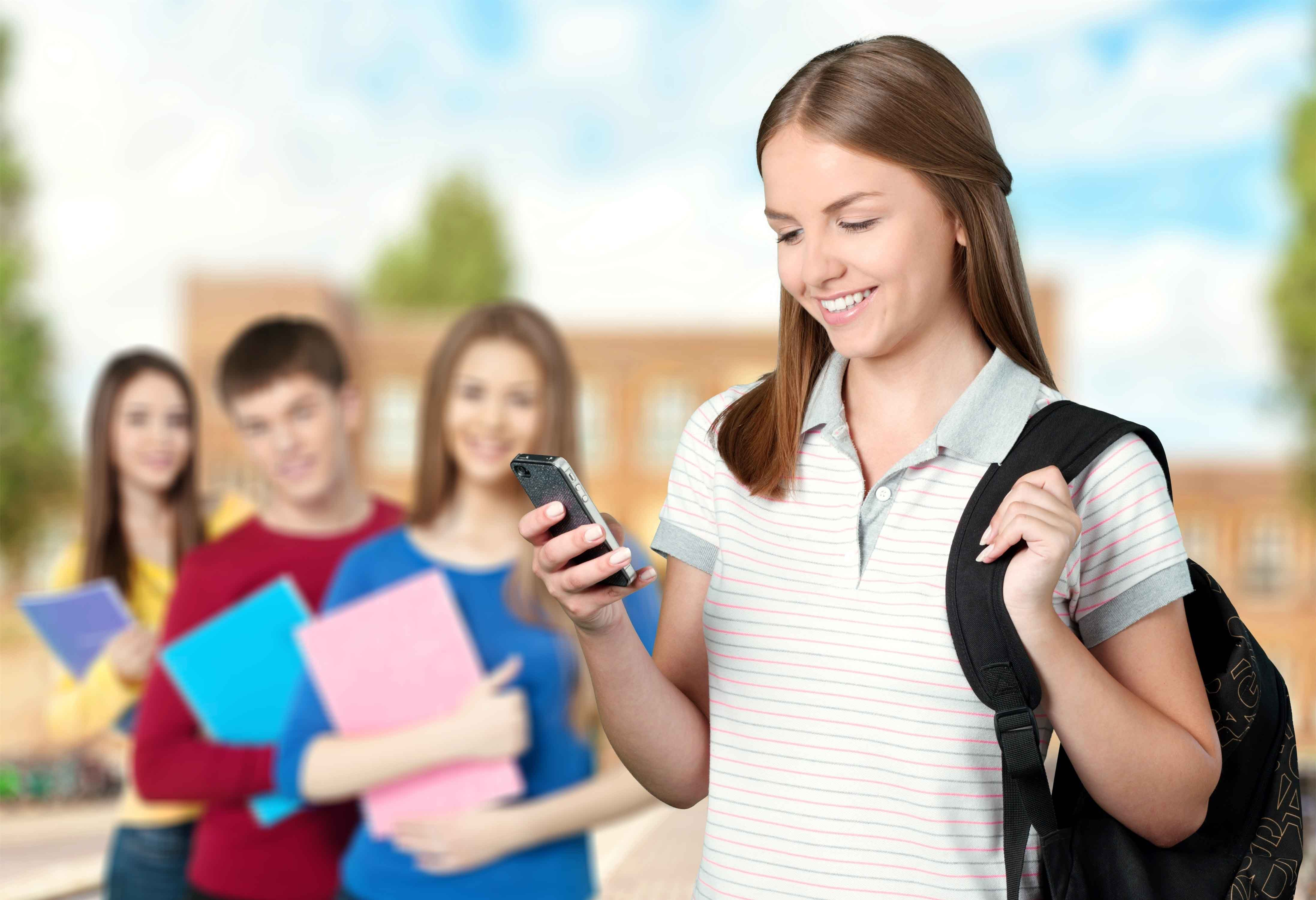 UA-PTC student on her mobile device